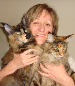 Jan Littlemore holding two cats